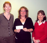 Ann Anderson (centre) donated £1000 to the Shetland Stroke Support Group, in memory of her late partner Laurence Henderson, from the Skerries.  The cheque was gratefully recieved on behalf of the group by Jane Astles and Dorothy Storey